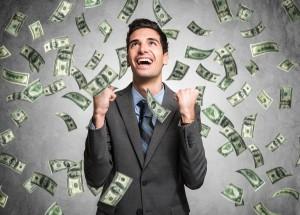Happy man enjoying the rain of money