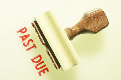 Past due stamp in red ink and stamper